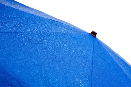 Horizontal view of a tilted blue umbrella with rain drops on white Stock Photo - 4264501