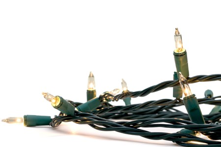 Clear white holiday lights with green cables
