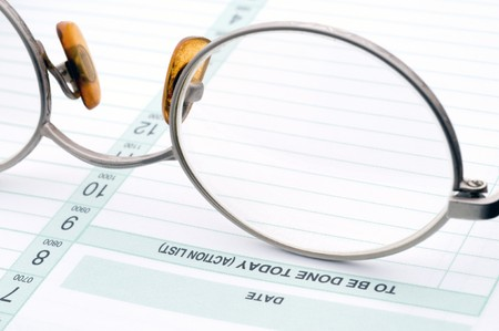 bifocals: eye glasses on a business day planner