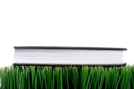 fescue: Green hardcover book sitting on grass with a white background