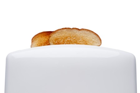 Toasted bread popping up from a white  toaster