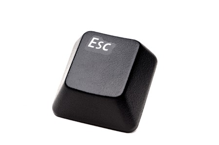 esc: A horizontal closeup of an Escape button from a computer keyboard on white Stock Photo