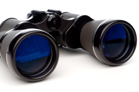 Horizontal close-up of binoculars on a white background