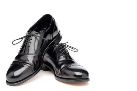 a pair of shining back dress business shoes on a white background
