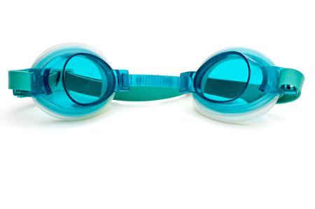 白い表面に青緑色のプラスチック水泳ゴーグルします。 写真素材