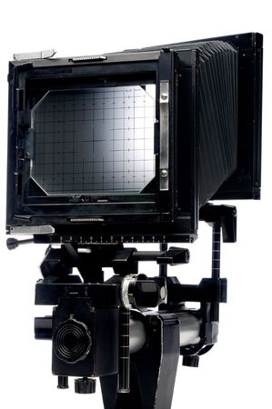 A vertical view of the back of a large format 4x5 view camera on white