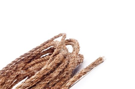 tilted view: A horizontal tilted view of a coil of rope on white