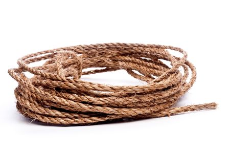 A horizontal view of a coil of rope on white