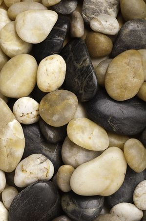 A close-up of numerous types of worn river rock Stock Photo