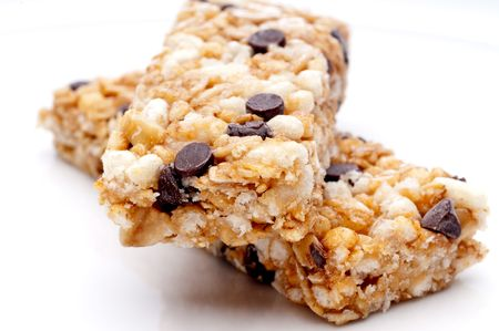 a horizontal close up of two granola bars on a white plate Imagens - 5025828