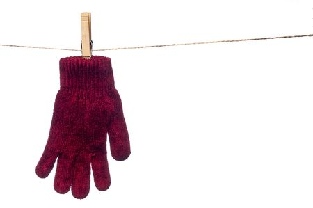 a horizontal image of a single red winter glove hanging on a clothes line Stock Photo - 5043822