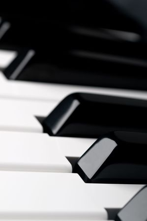A shallow focus close up of piano keyboard  keys