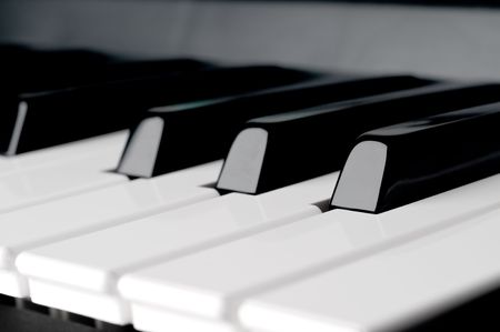 A shallow focus horizontal close up of piano keyboard  keys