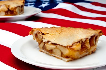 pcs: Shallow focus horizontal image of 2 pcs of apple pie on the American flag Stock Photo