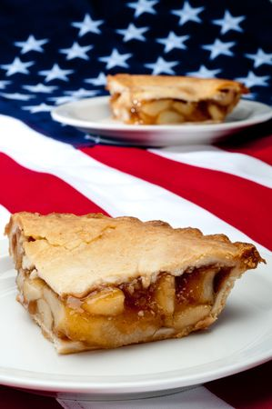 Shallow focus vertical image of 2 pcs of apple pie on the American flag