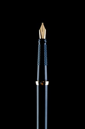 Vertical image of a black fountain pen on black