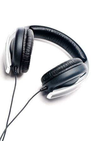padding: Tilted vertical image of silver colored headphones with black leather padding