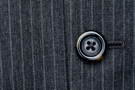 Close up of a button on a pin striped business suit coat Imagens - 5186858