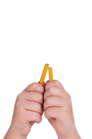 A vertical image of a broken lead pencil in a childs hands on white copy space