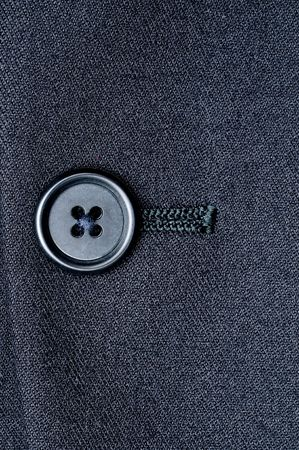 Close-up of a closed button on a suit jacket