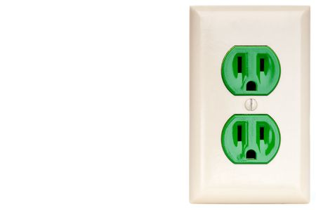 conductivity: horizontal image of a green power outlet receptacle with copy space Stock Photo
