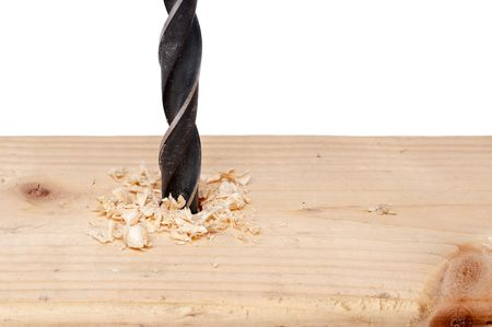 A horizontal close up of a hole being bored into wood with a drill bit Stock Photo - 5262428
