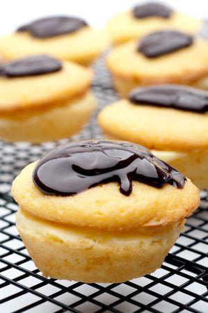 vertical shallow focus close-up of a Boston Cream Pie Cupcake