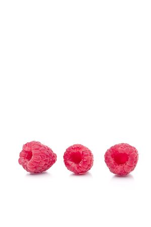 A vertical image of three fresh raspberries on white Stock Photo - 5279828