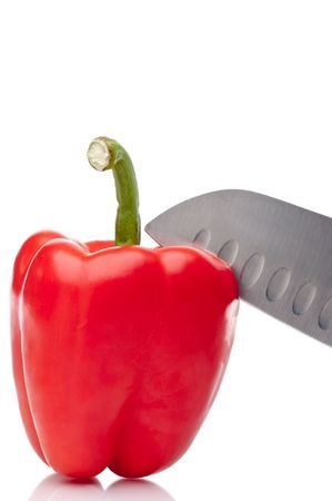 a vertical image of a red pepper being sliced on white Stock Photo - 5279831