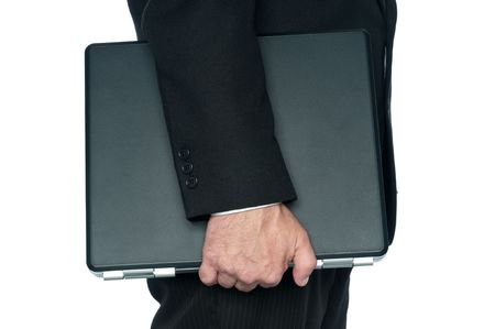 Horizontal image of a man in a business suit carrying a notebook computer Stock Photo - 5355342