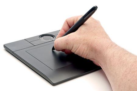 A male hand operating a pen computer input device Reklamní fotografie