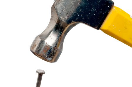A hammer about to hit the nail on the head on white Stock Photo - 5522115
