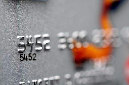 Shallow focus horizontal macro of a silver credit card Stockfoto