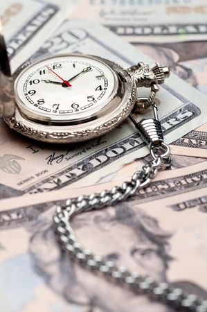Time is money - a pocket watch on American currency