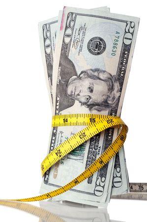 それの周りに巻尺とアメリカのお金