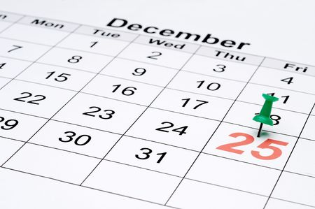 Horizontal image of a calendar with Christmas day marked with a green tack Stockfoto