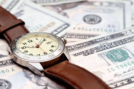 Horizontal image of a wristwatch on American currency Imagens