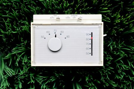 an old inefficient thermostat on grass