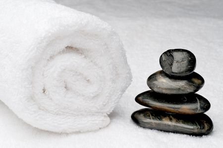Spa towel with dark spa stones Stock Photo - 5650825