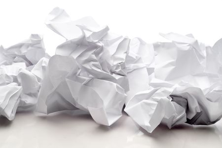 Tossed sheets of white paper