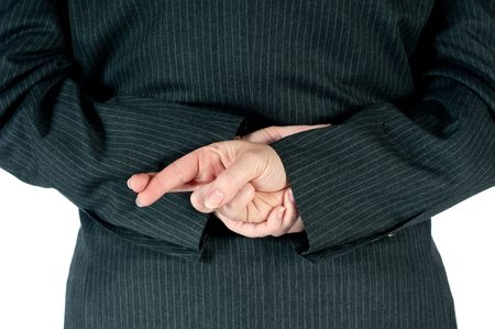 Persona de negocios de mujeres con los dedos cruzados detr�s de espalda