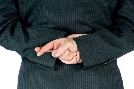 Persona di affari femmina con le dita incrociate dietro la schiena  Archivio Fotografico - 5881389