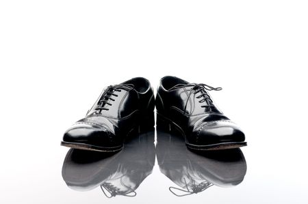 Black leather business shoes on a reflective surface Stock Photo - 5893021