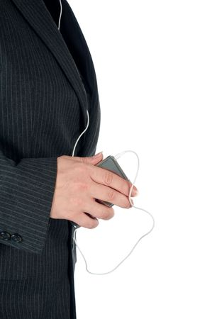 Vertical image of a female business person with a portable music player