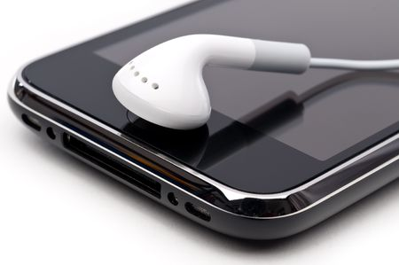 earpiece: Close upof a personal music player with an earbud