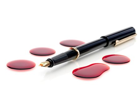 Close up of a pen and blood  Imagens