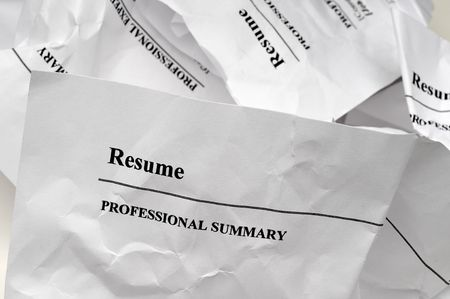resumes crumpled up and tossed in frustration
