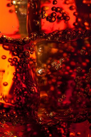 Abstract macro of bubles on ice in a soft drink