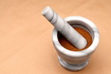 horizontal close up of spice in a mortar and pestle on brown Stock Photo