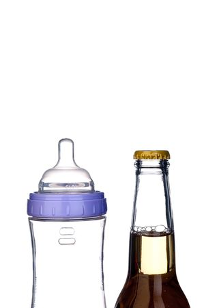 baby bottle and beer bottle on white: from one bottle to the next photo